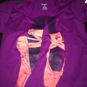 purple reebok shirt with ballet point shoes